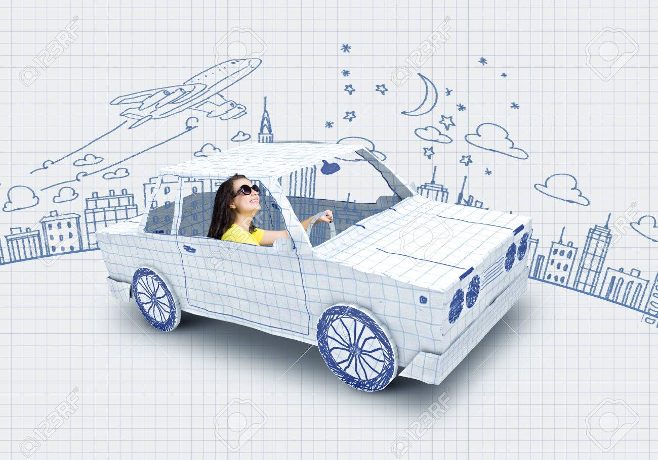 Young woman riding car made of list of paper - 31940544