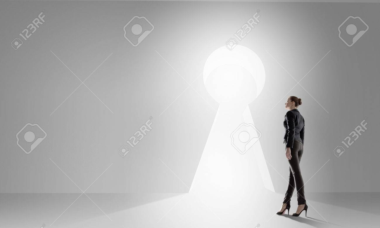 Back view of businesswoman standing in keyhole doorway Stock Photo - 34738617 & Back View Of Businesswoman Standing In Keyhole Doorway Stock Photo ...