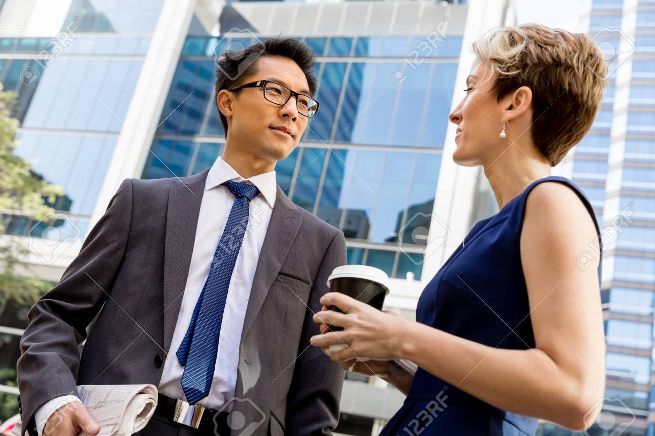 df511ae4c0ee Business people having a talk while walking in a businesss district Stock  Photo - 40862152