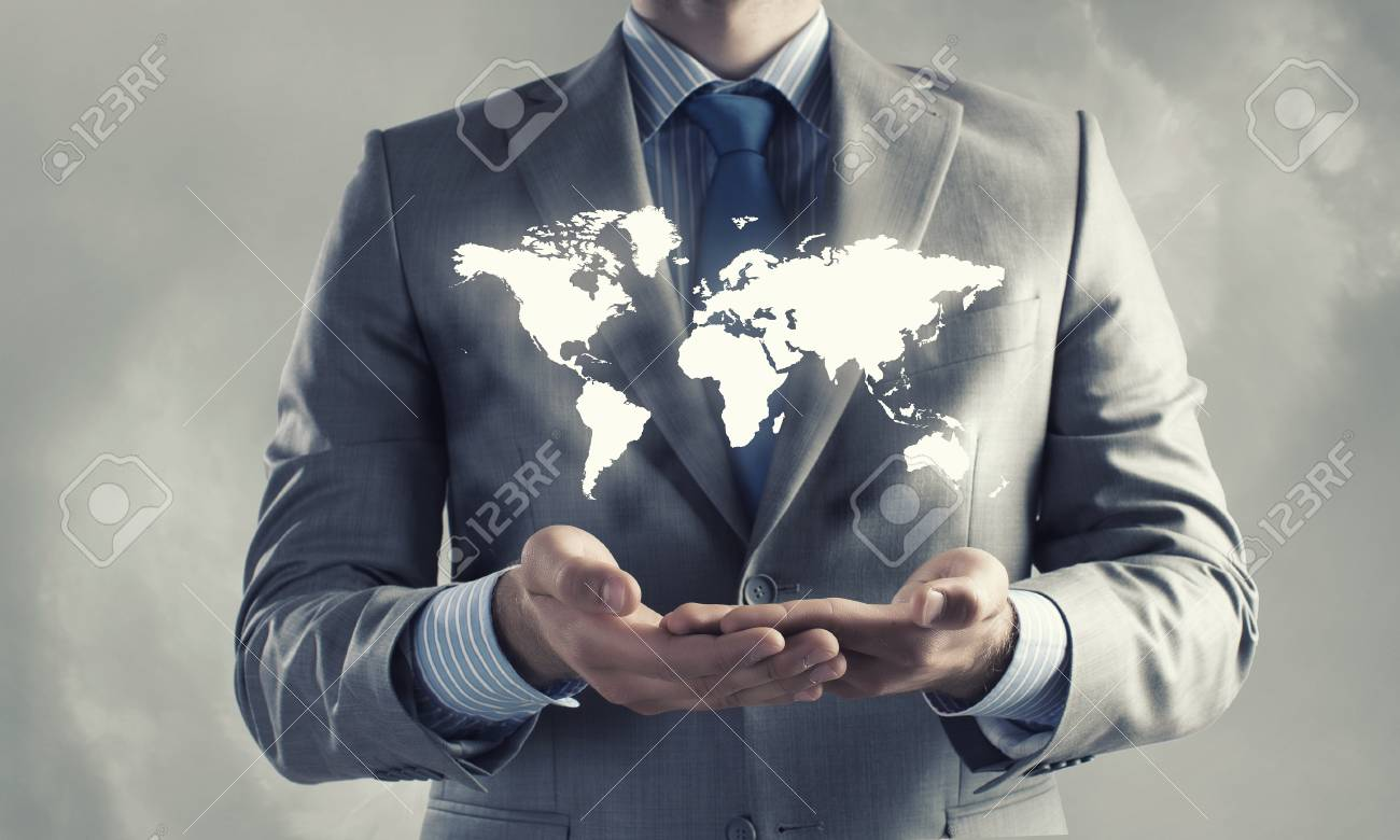 World Map On Hands.Close Up Of Businessman Holding World Map In Hands Stock Photo