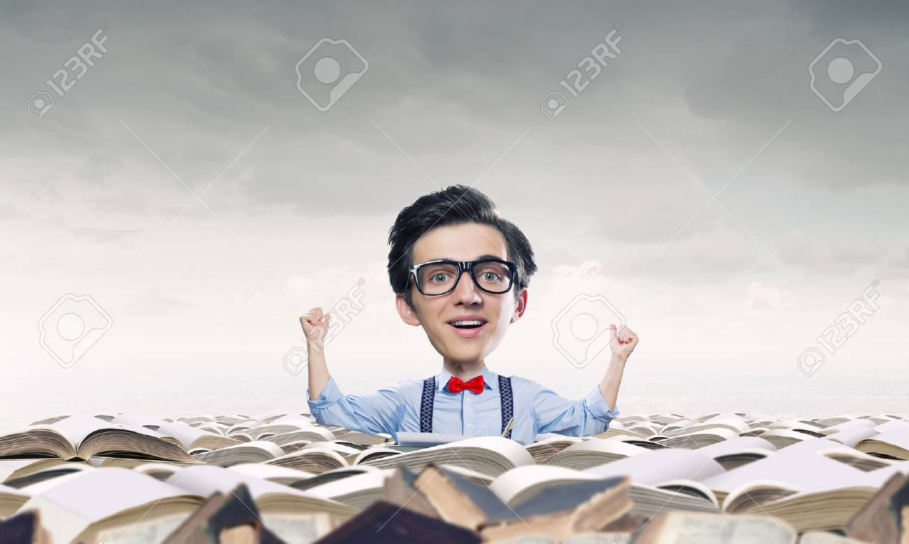 19b058055c Stock Photo - Young funny man in glasses with big head among pile of old  books