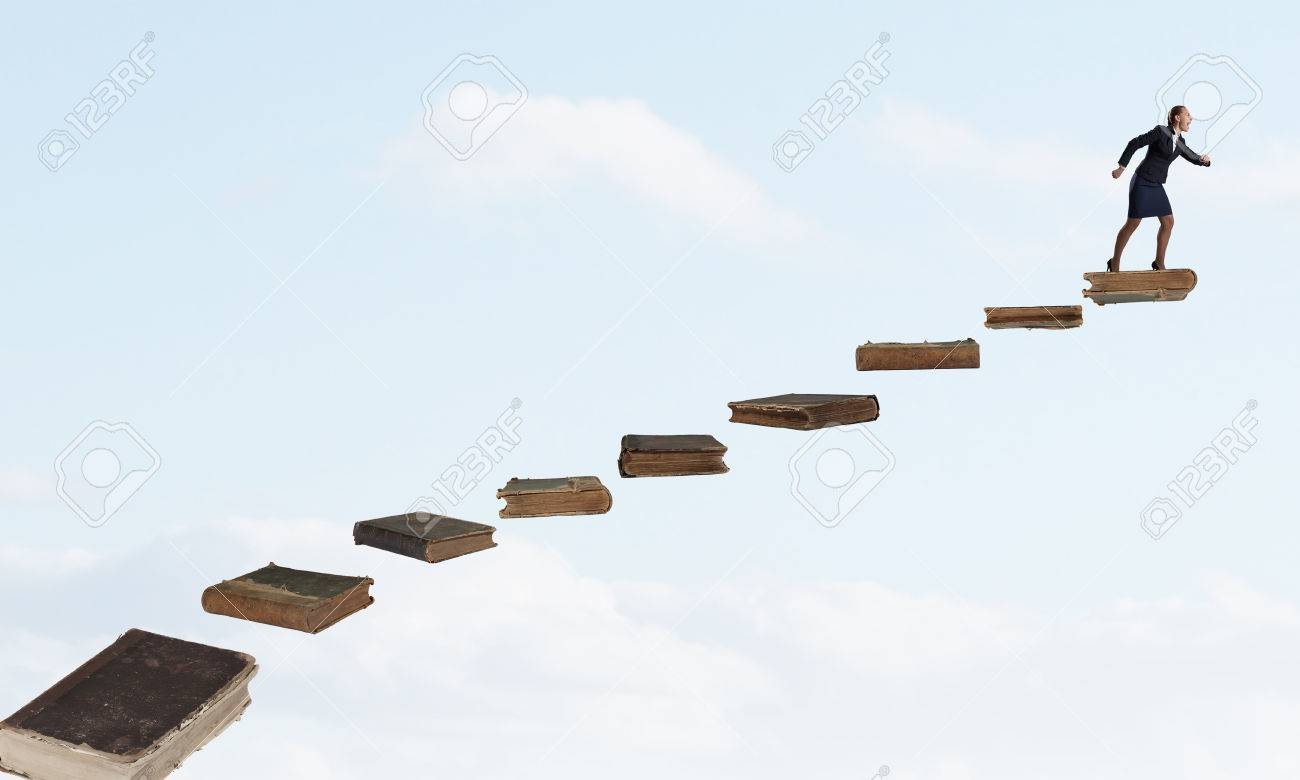 Determined Businesswoman Climbing Up Ladder Of Books Stock Photo ... for Student Climbing Ladder  165jwn
