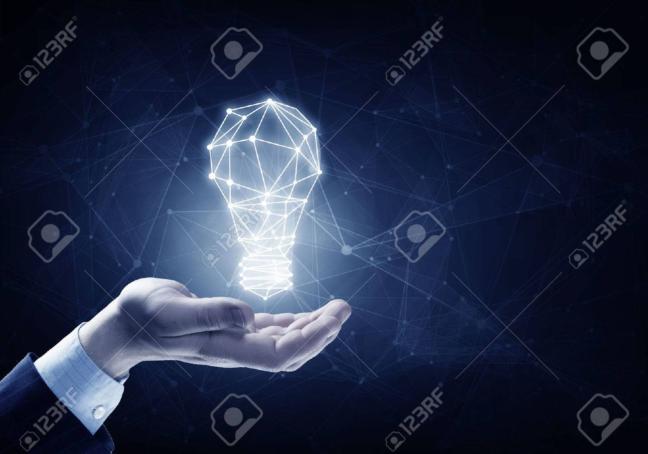 Hands of business person holding illuminated light bulb sign - 50230699