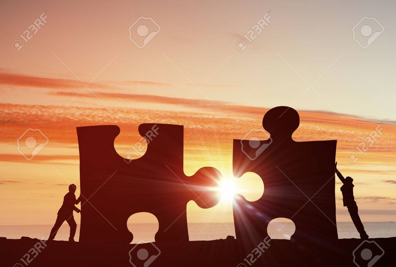 Business people connecting puzzle elements representing collaboration concept - 50358765