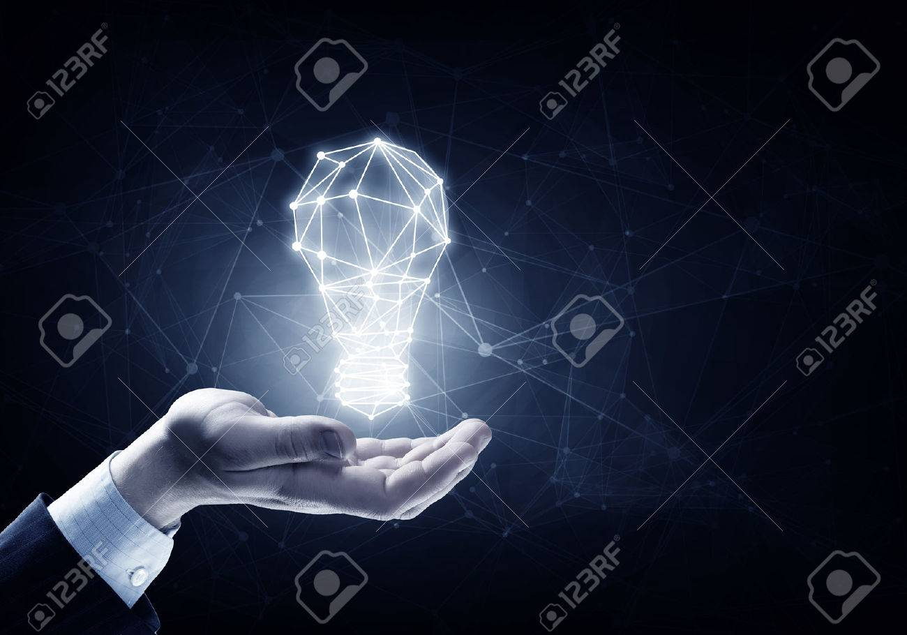 Hands of business person holding illuminated light bulb sign Stock Photo - 50360427