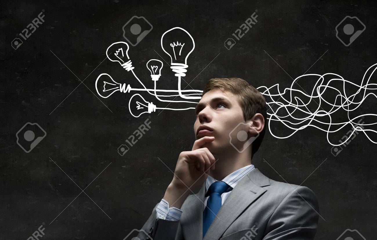 Thoughtful businessman with arrows and thoughts coming out of his head - 50598014