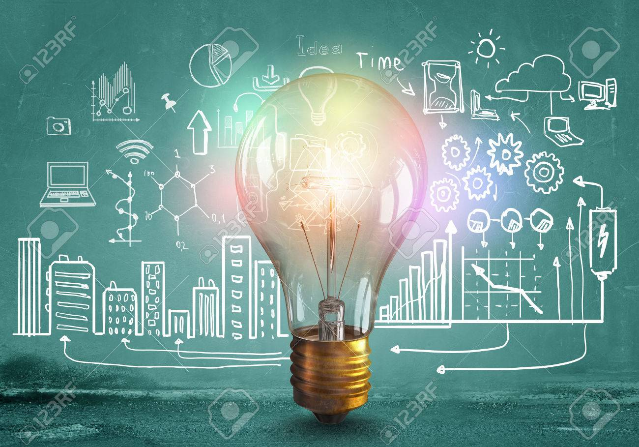 Glass glowing light bulb and business sketched ideas Stock Photo - 50638441