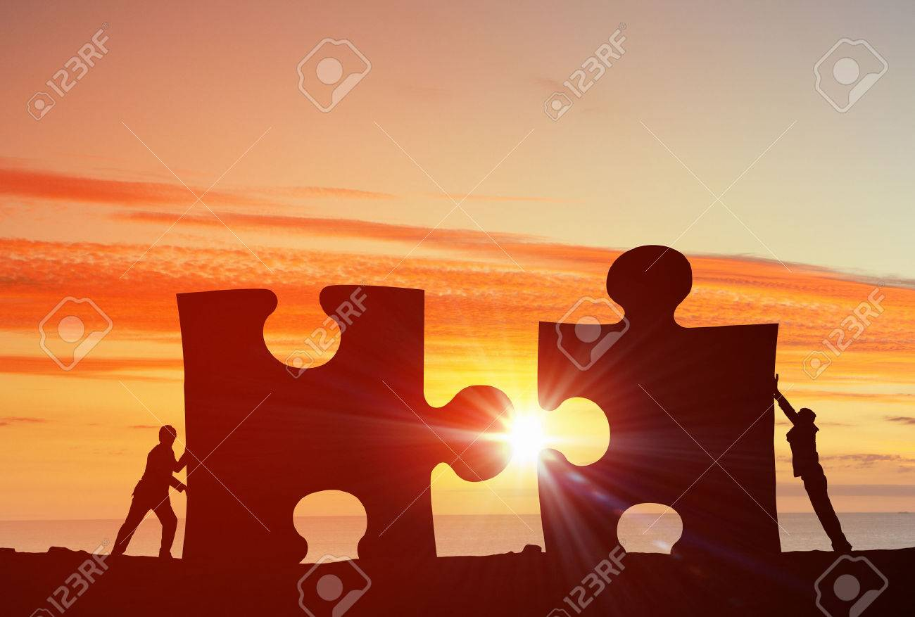 Business people connecting puzzle elements representing collaboration concept Stock Photo - 50682847