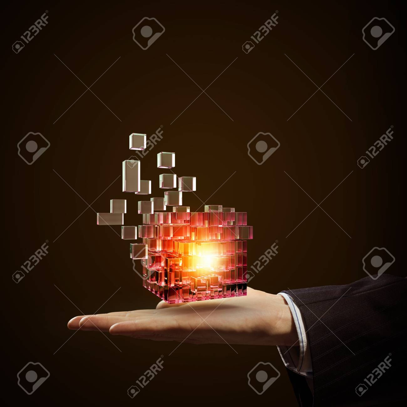 Businessman close view holding in hand magic glowing cube - 50964132