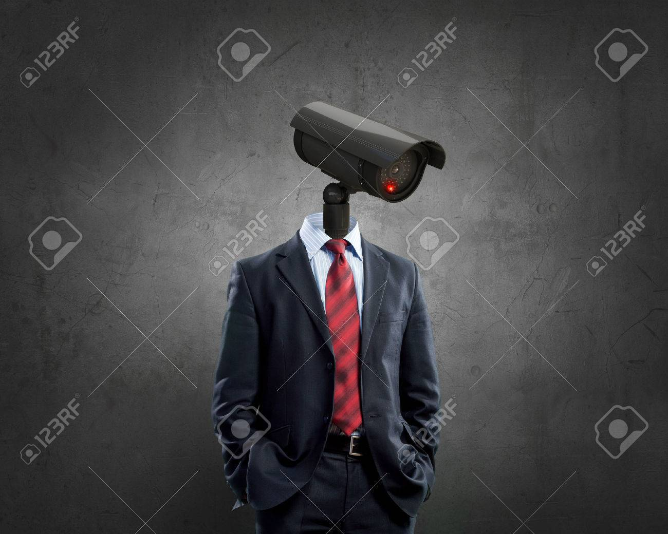 Portrait of camera headed man in suit as security concept - 51859675