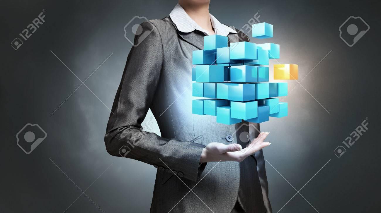 Close view of businesswoman shows cube as symbol of modern technology Standard-Bild - 51995604