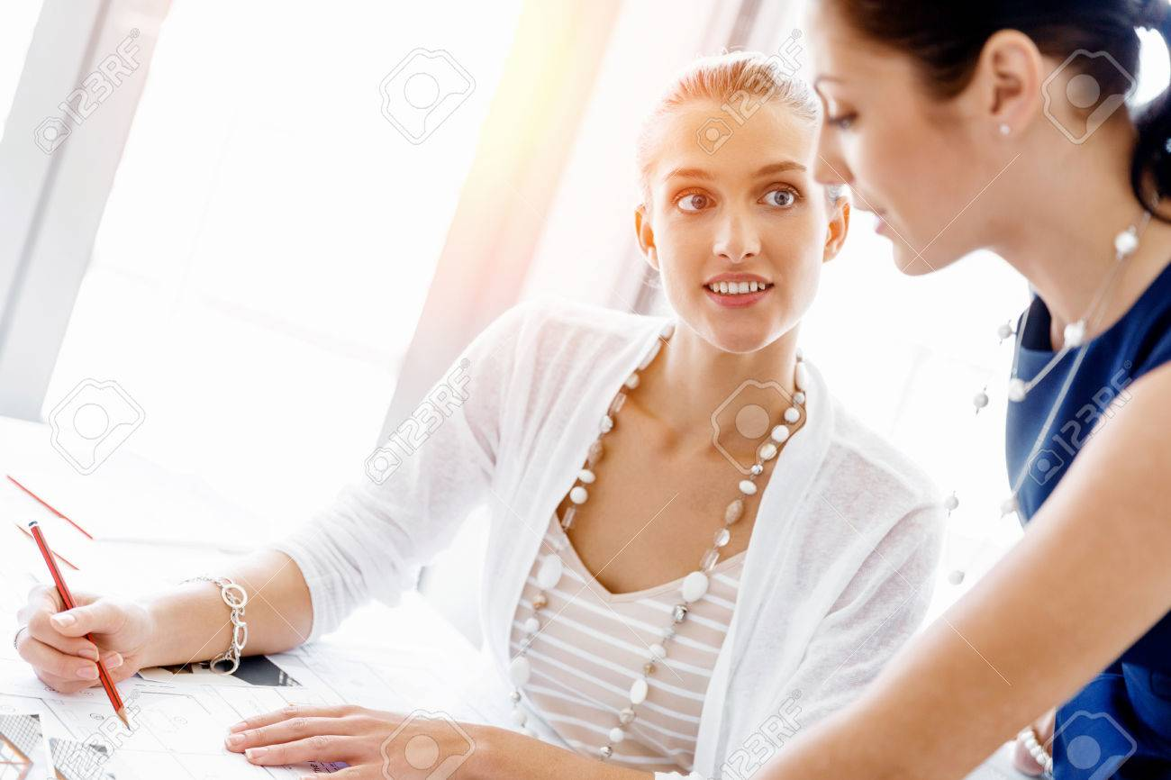 Two female colleagues working together in office Standard-Bild - 52847122