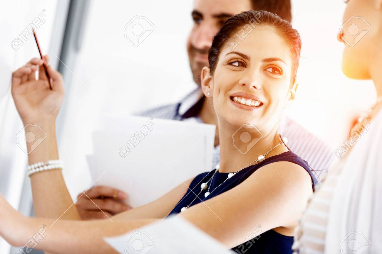Business people working and discussing in modern office Stock Photo - 54270149
