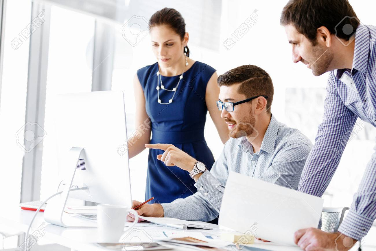 Business people working and discussing in modern office - 54450714