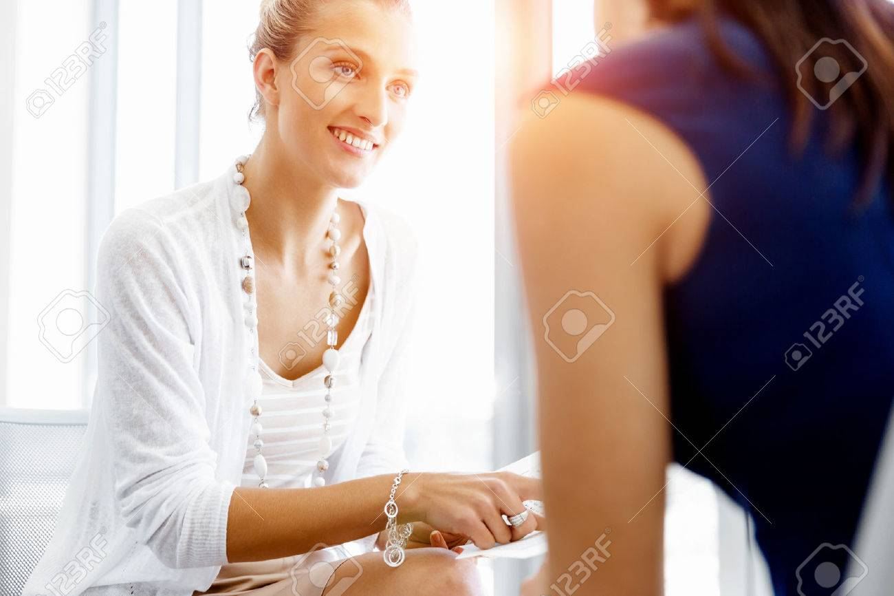 Two female colleagues working together in office Stock Photo - 54553976