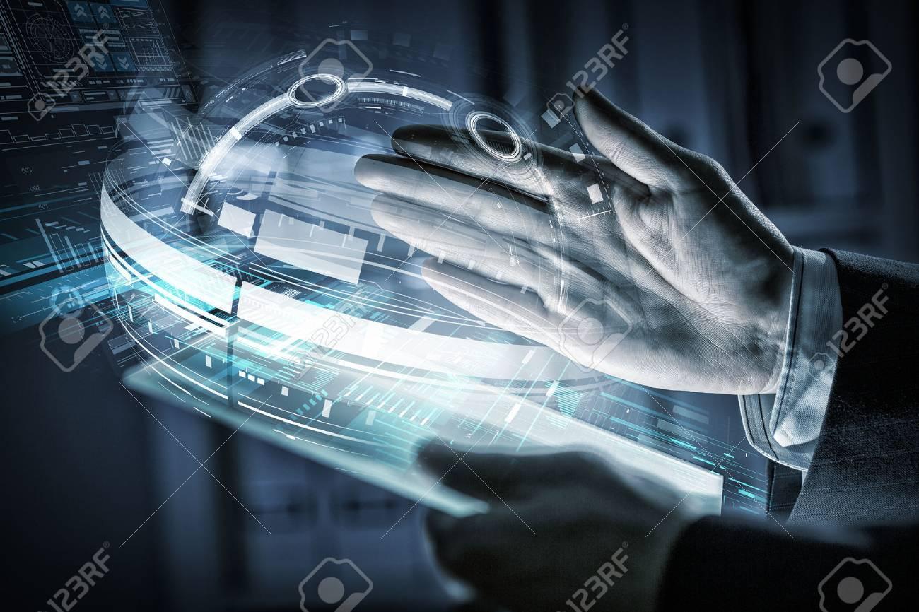 Close up of human hands using virtual panel - 54575516