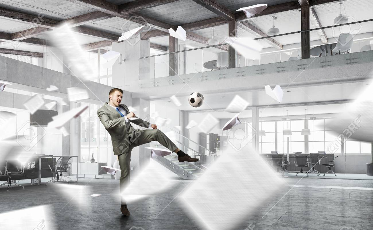 playing office soccer stock photo 79951638