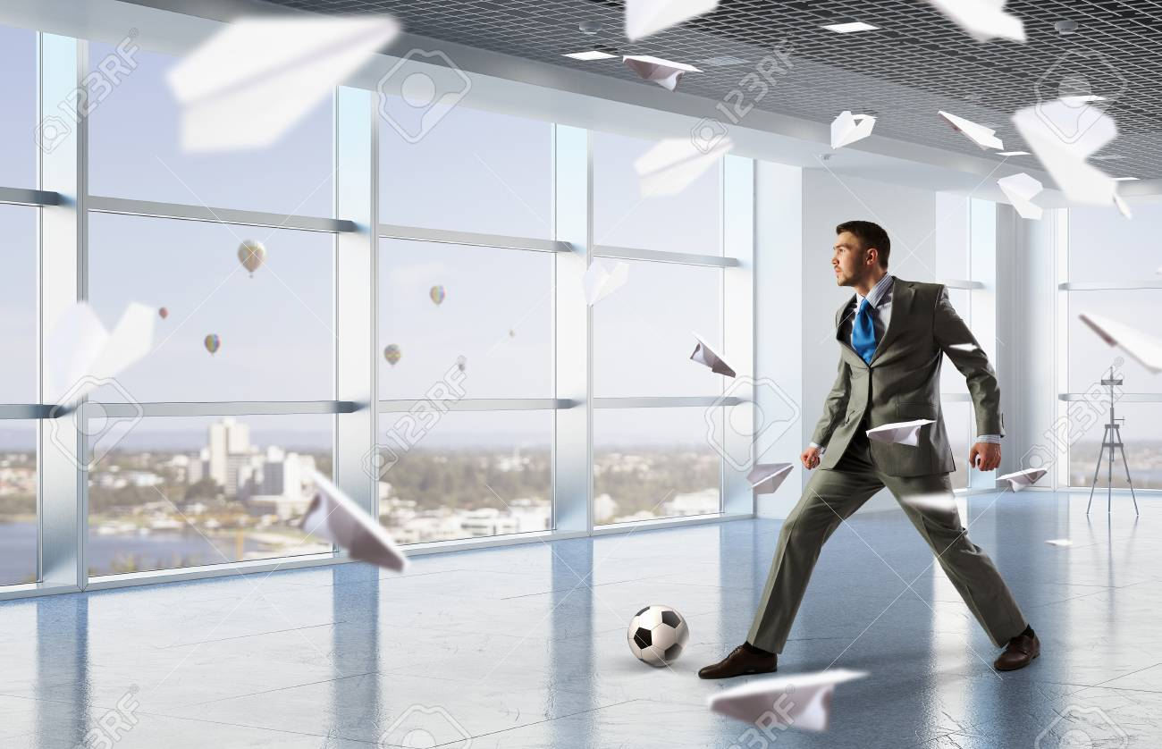 playing office soccer stock photo 80186835