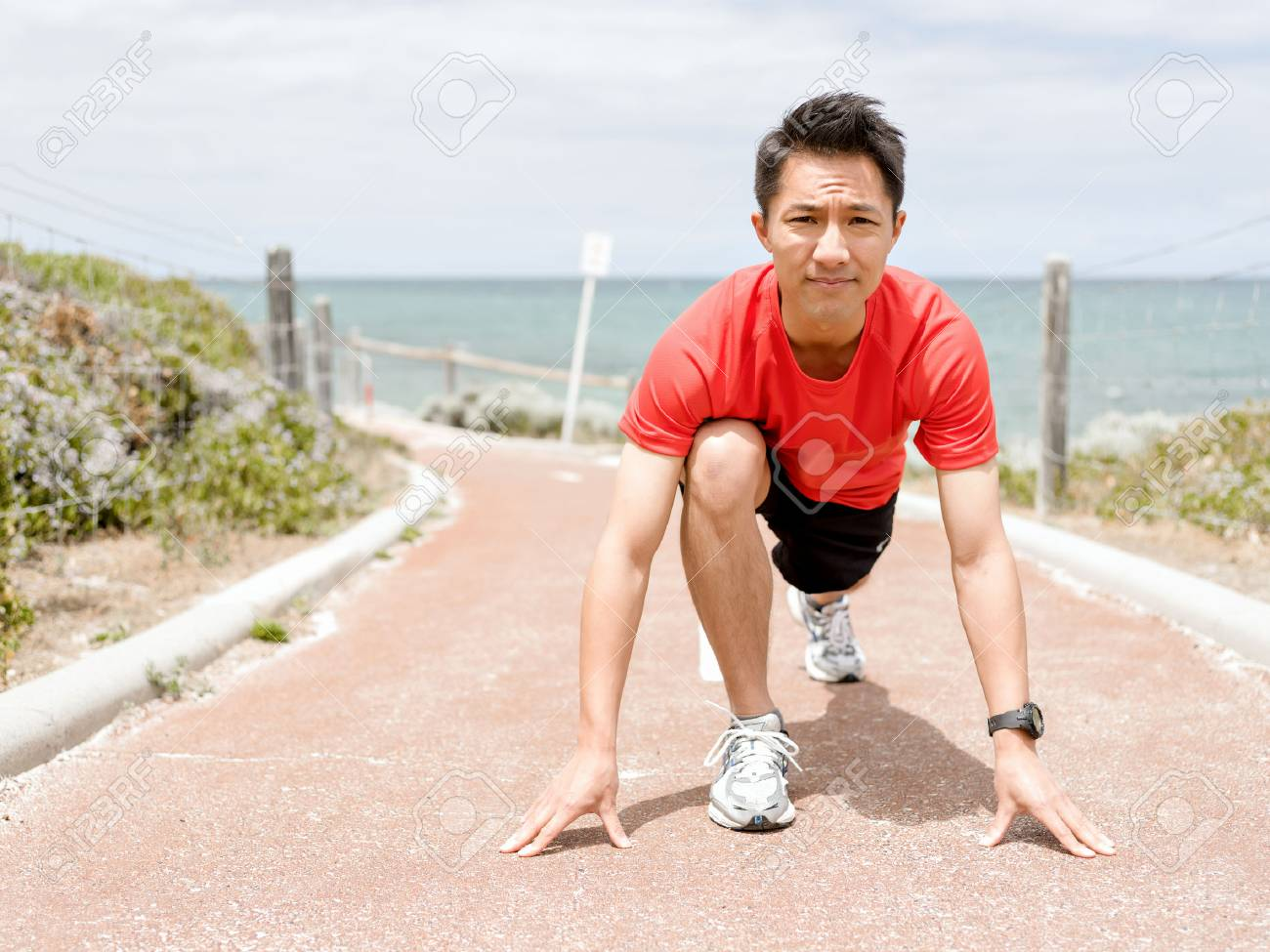 Young man getting ready for a run - 89498867