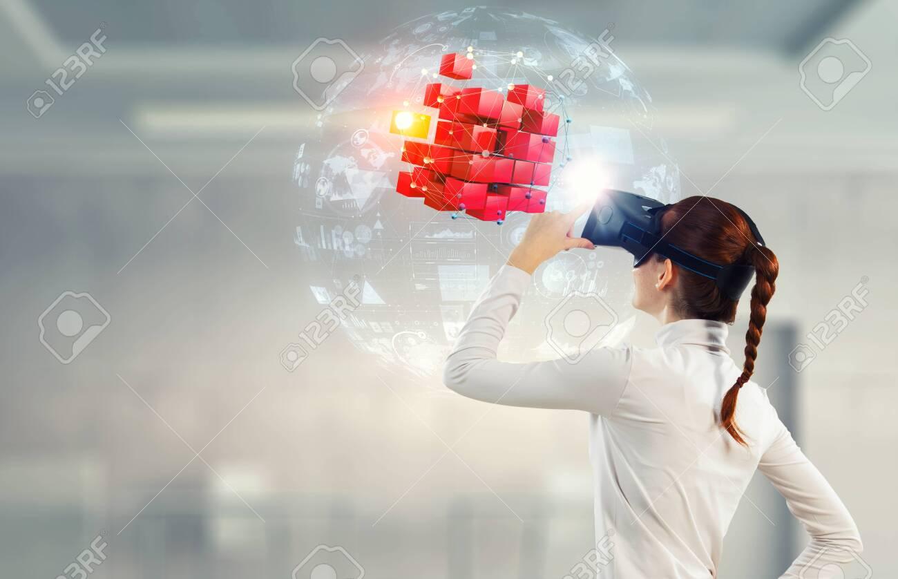 Experiencing virtual technology world. Mixed media - 118895224