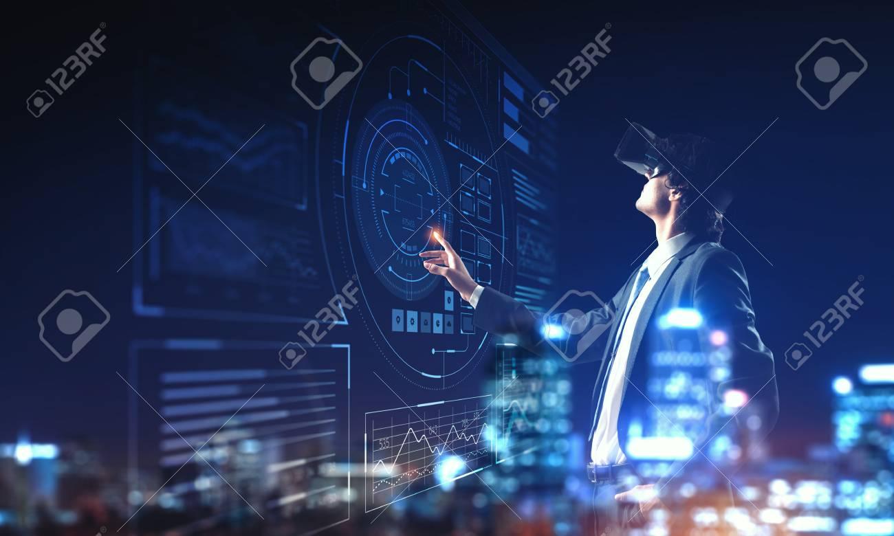 Businessman having VR experience. Mixed media - 119224044