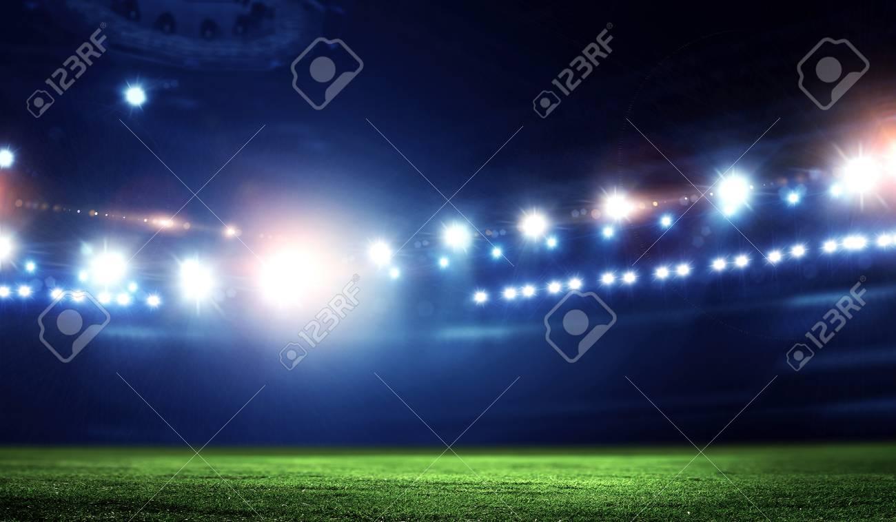 Empty night football arena in lights - 121615340
