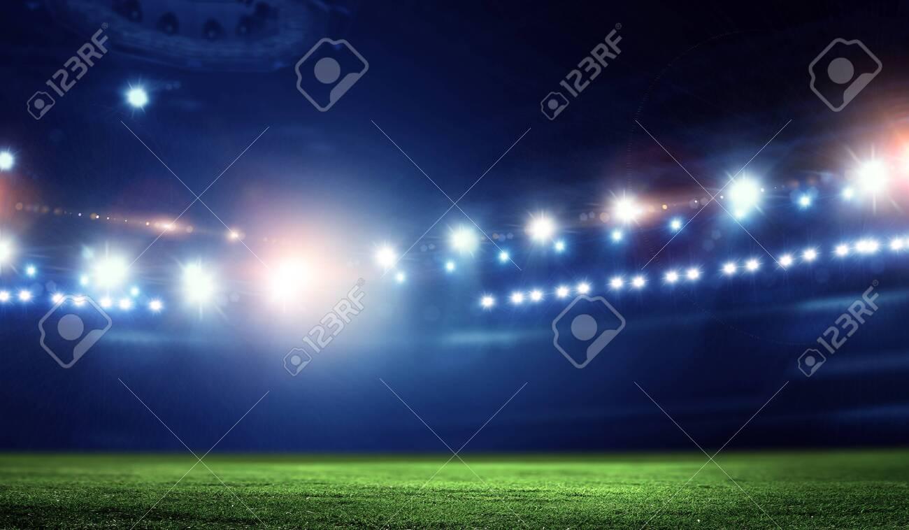 Empty night football arena in lights - 126889712