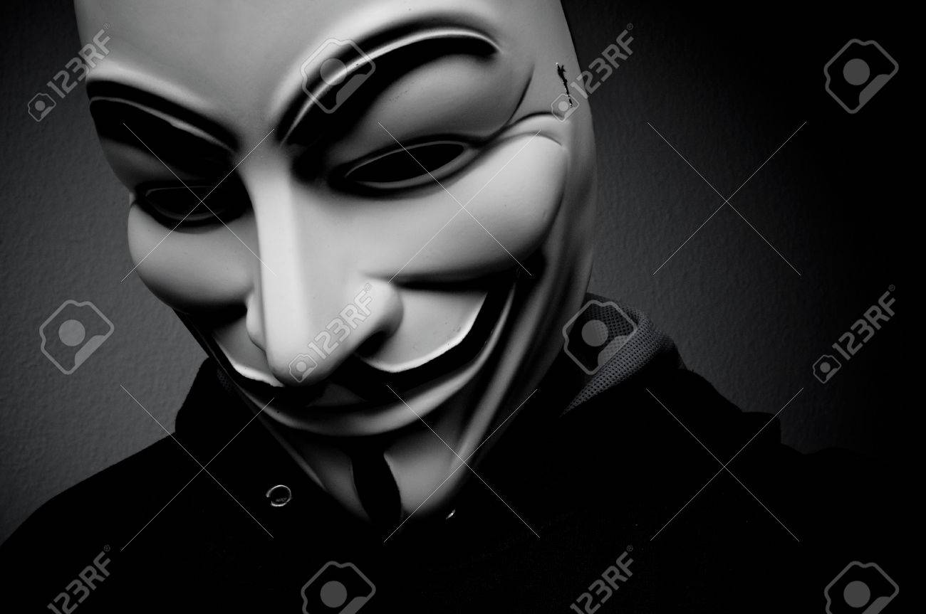 Paris - France - 18 January 2015 - man wearing Vendetta mask. This mask is a well-known symbol for the online hacktivist group Anonymous - 35783410