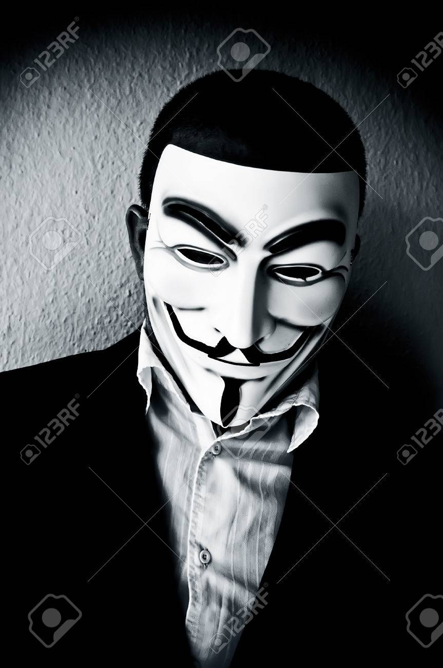 PARIS - France - 22 April 2015 - man wearing suit businessman and Vendetta mask. This mask is a well-known symbol for the on line hacktivist group Anonymous - 39069398