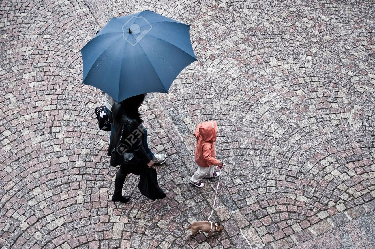 women with umbrella in the rain - 45703833