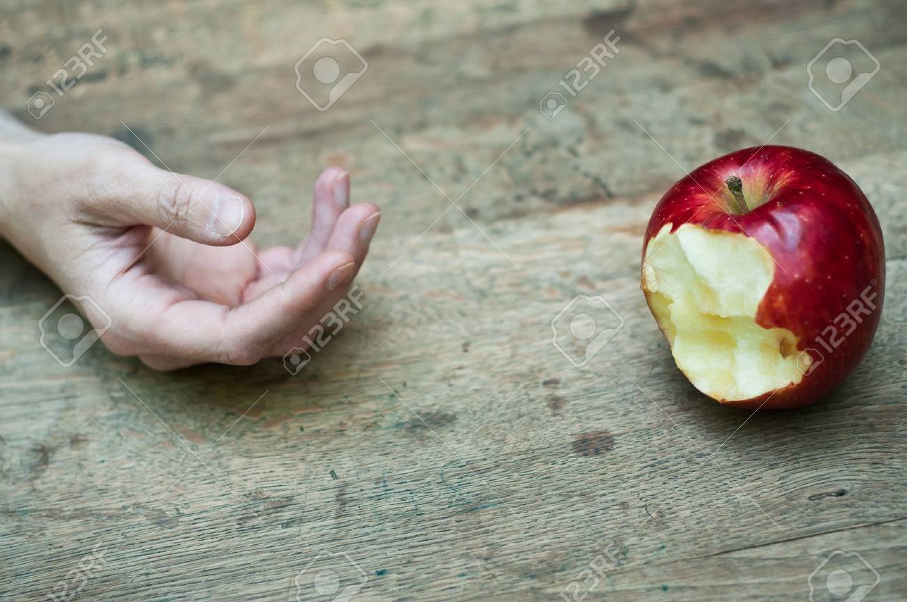 red apple temptation concept on wooden table - 56250375
