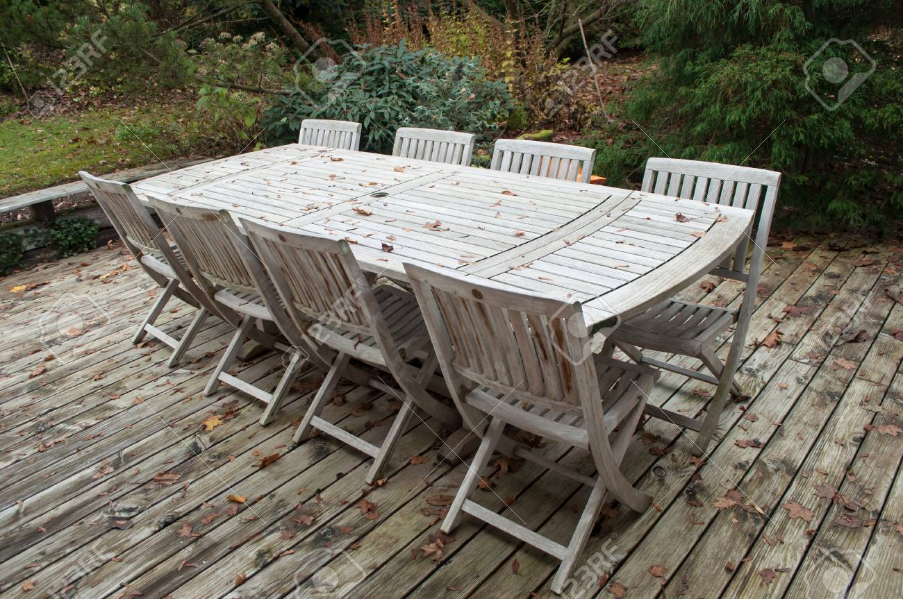 Teak Garden Table >> Teak Garden Furniture On A Terrace In Autumn