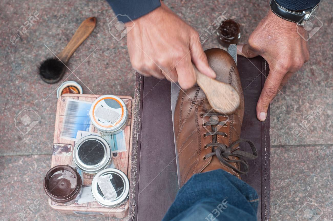 closeup of shoe shine in the street on brown leather shoes - 85399950