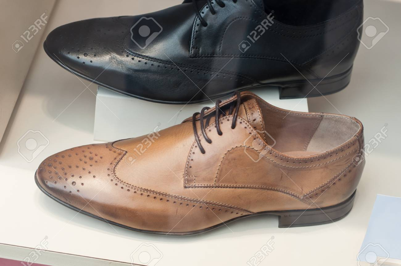 closeup of classic leather shoes for men in fashion store showroom