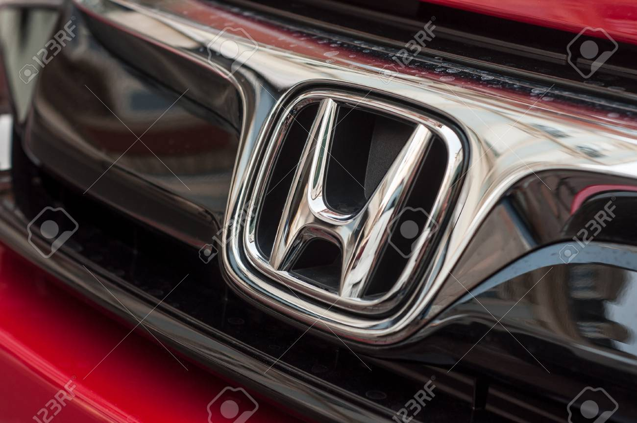 Mulhouse - France - 8 April 2018 - Closeup of Honda logo on red Honda civic car front - 104638832