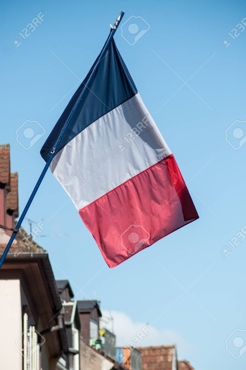 Closeup of french flag on building facade in an asatian village - 103364128