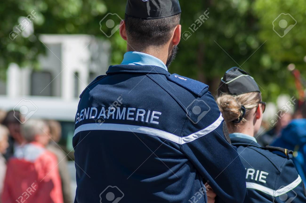 Brisach - France - 1 May 2018 - french gendarmerie patrol in lily of the valley party in the street - 104639074