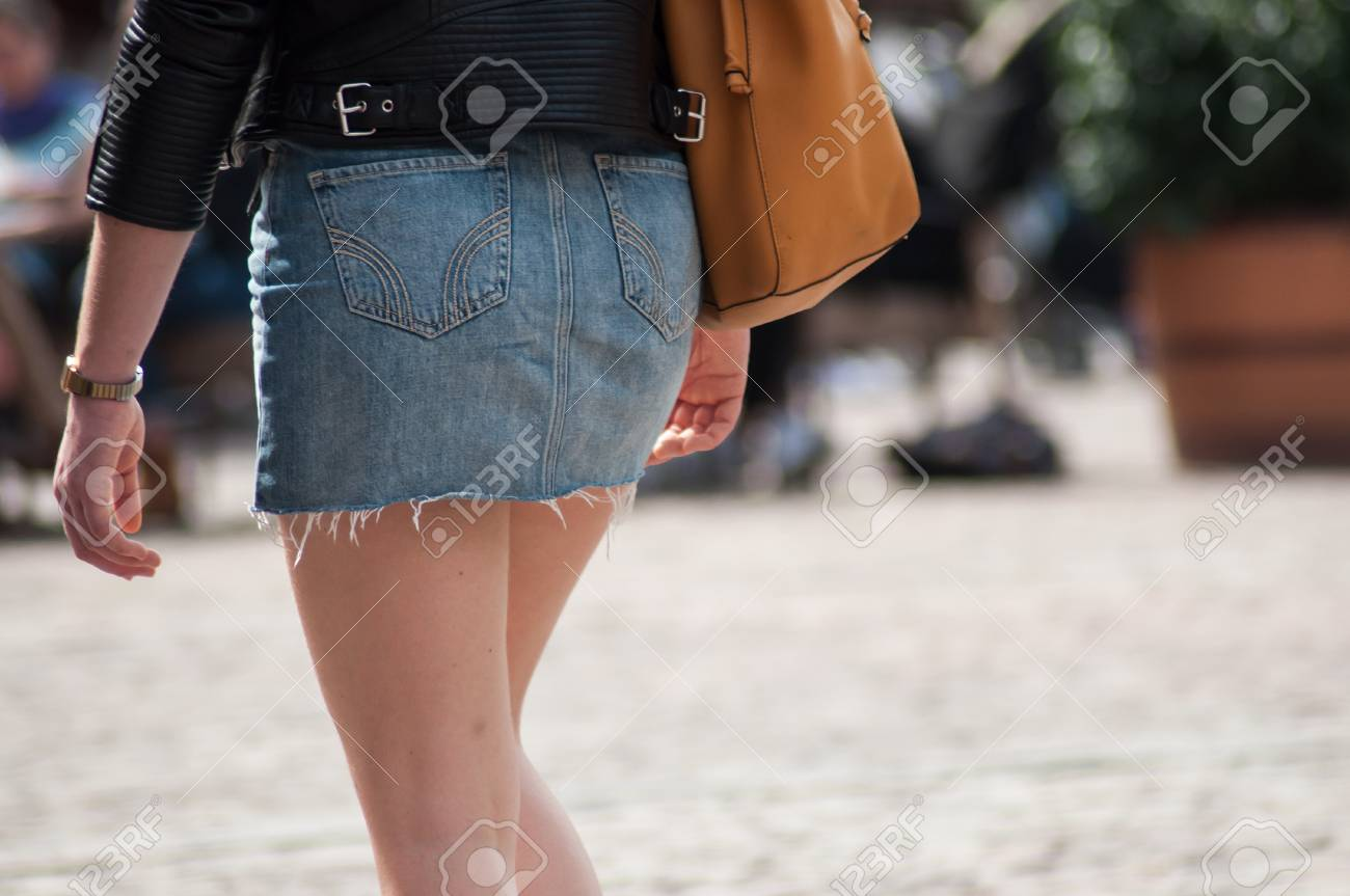 closeup of girl wearing mini blue jeans skirt in the street - 121611161