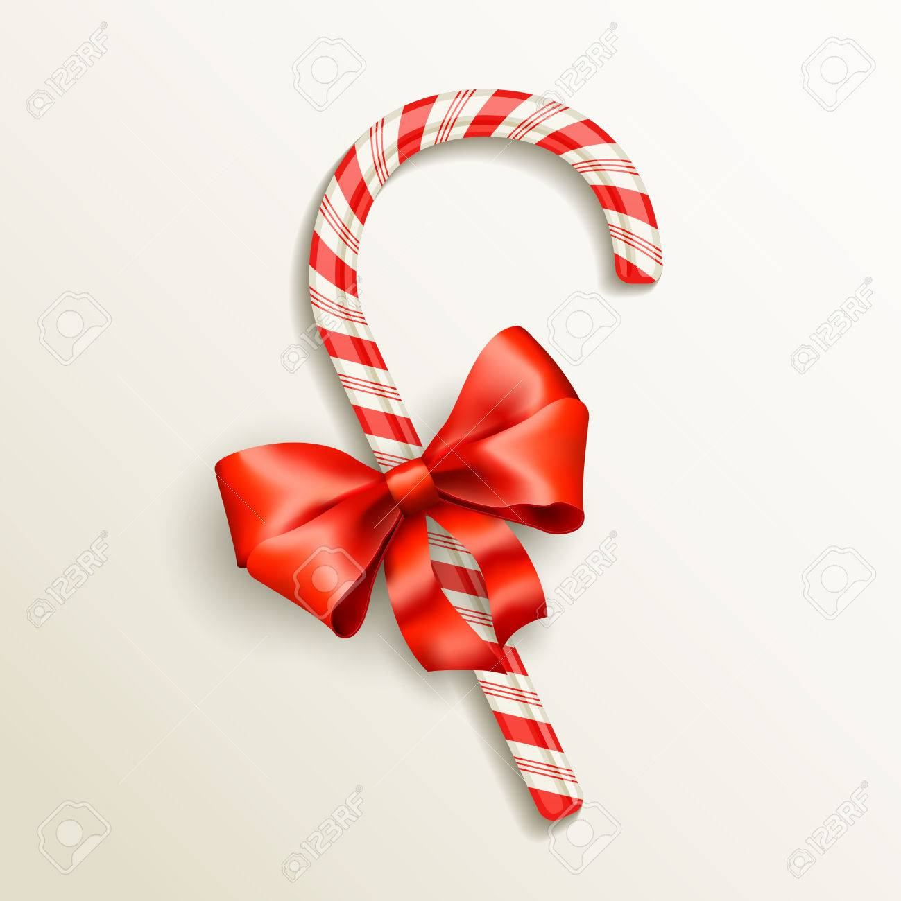 realistic candy cane with red bow vector illustration Stock Vector - 25996729