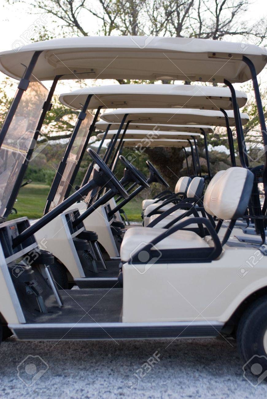 Several golf carts lined up in a row at country club, at sunset Stock Photo - 3108257