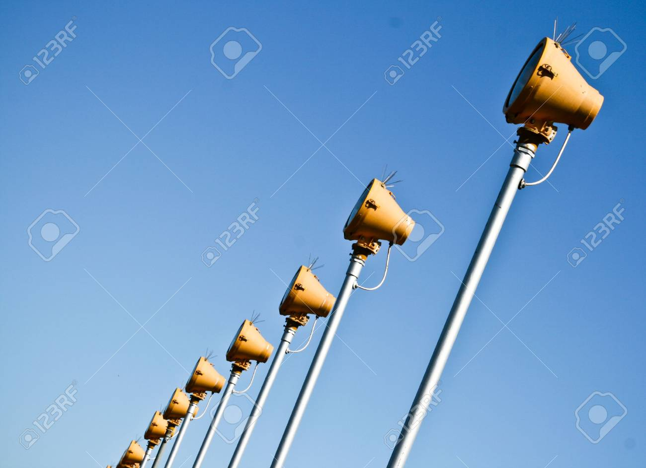 Alignment Of Several Light Projectors On A Blue Sky Background Stock Photo - 5370559