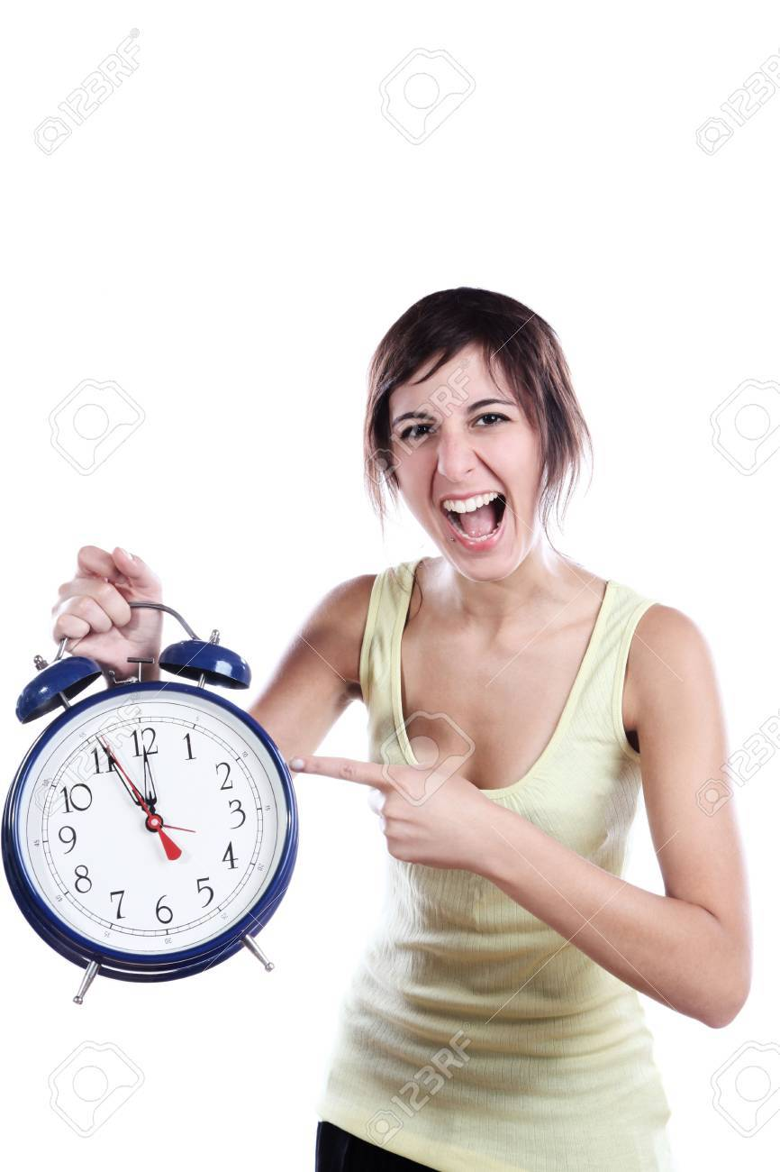 Expressive Young Woman Holding A Big Alarm Clock And Pointing The Time Stock Photo - 5768820