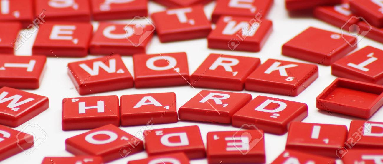 Work Hard Word With Crossword Background Stock Photo Picture And
