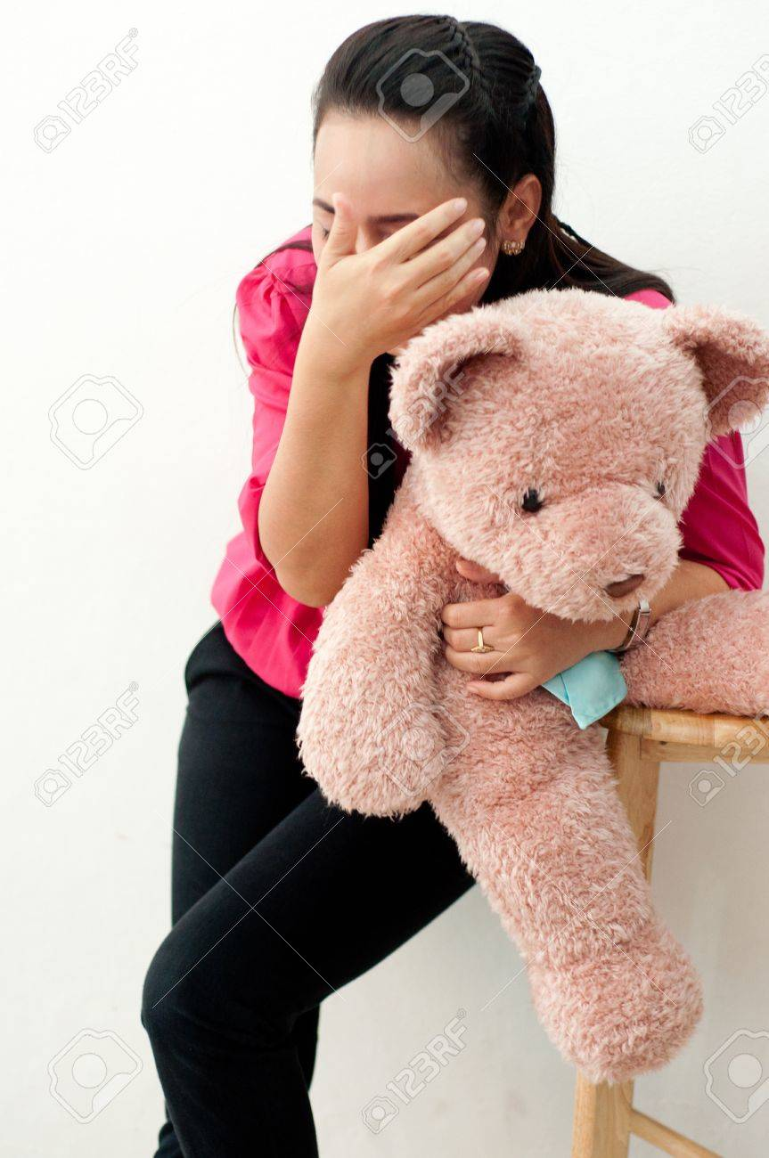 Asian thai attractive woman in red shirt isolate on white hugging asian thai attractive woman in red shirt isolate on white hugging big bear doll stock publicscrutiny Gallery