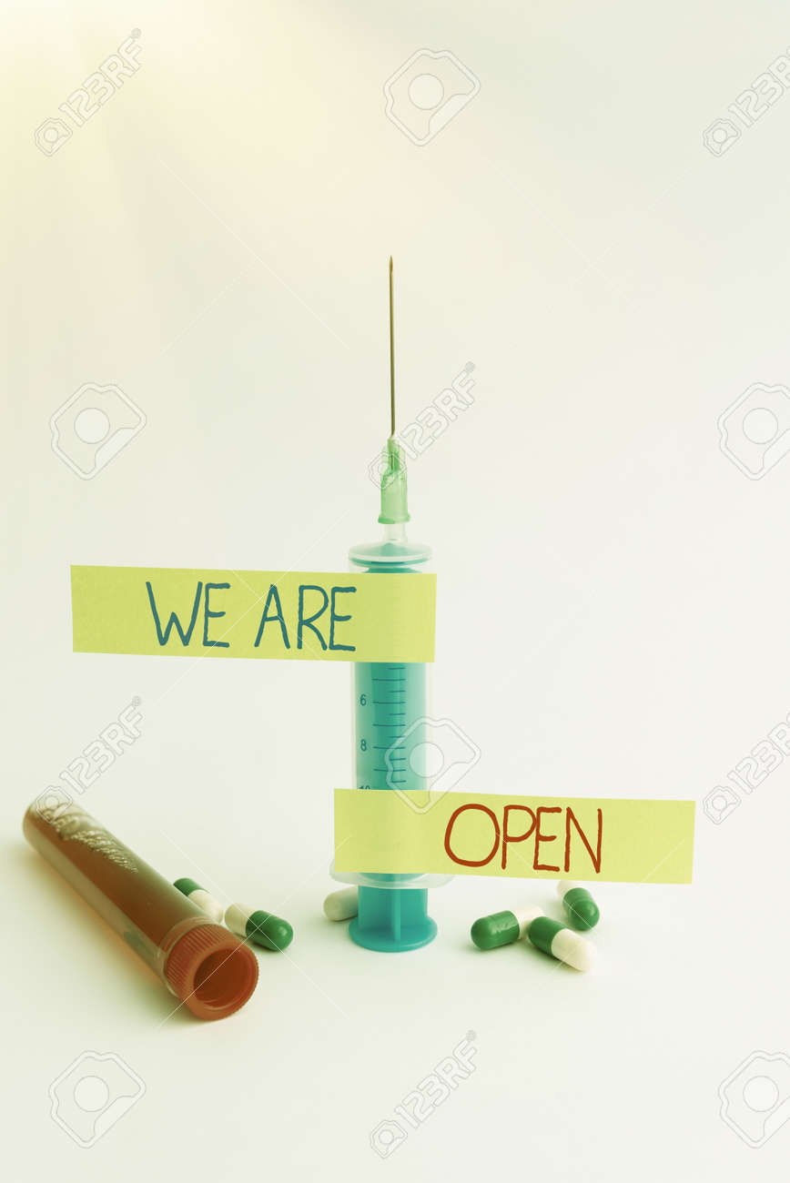 Text caption presenting We Are Open. Business approach no enclosing or confining barrier, accessible on all sides Writing Important Medical Notes Laboratory Testing Of New Infections - 172519891