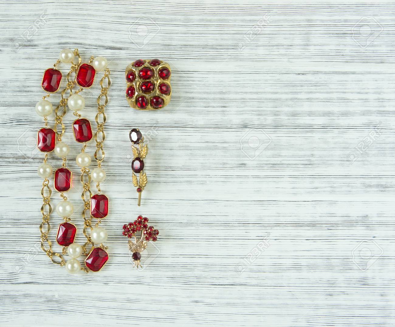 Stock Photo   Womanu0027s Jewelry. Vintage Jewelry Background. Beautiful Bright Rhinestone  Brooch And Necklace On Wood Background. Flat Lay, Top View With Copy ...