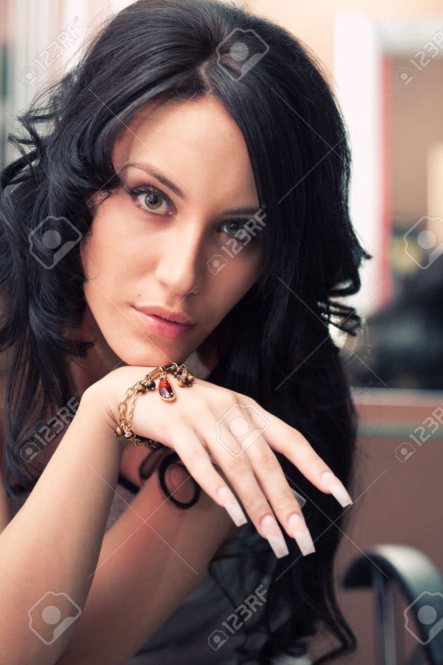 Portrait of attractive girl with beautiful hairstyle and long nails Stock Photo - 5085128