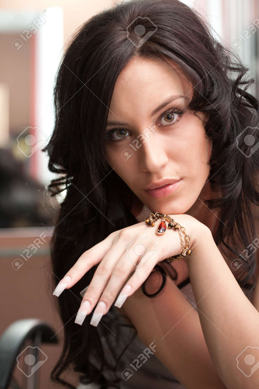 Portrait of attractive girl with beautiful hairstyle and long nails Stock Photo - 5611632