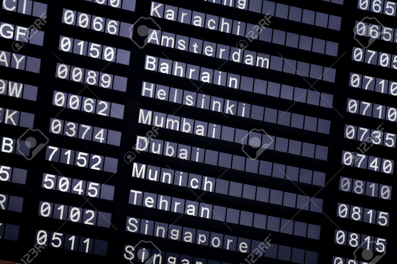 A flight schedule at the airport show Karachi, Amsterdam, Bahrain, Helsinki, Mumbai, Dubai, Munich, Tehran, Singapore Stock Photo - 7559626