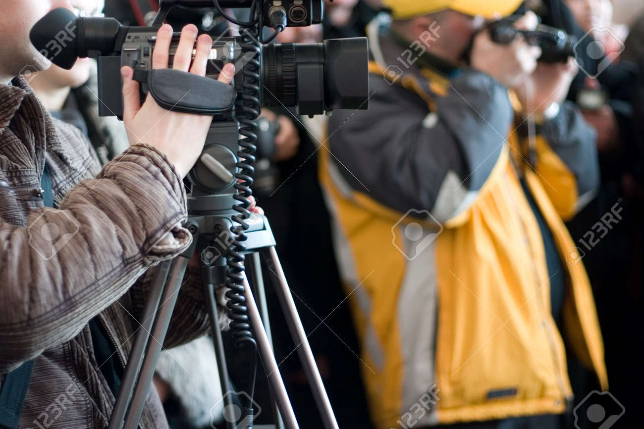 Group of journalists with photo and video cameras shooting some event Stock Photo - 837023